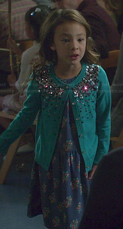Lily's blue floral print dress and embellished cardigan on Modern Family