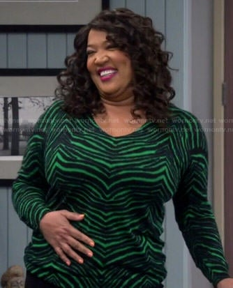 Yolanda's green zebra print sweater on Young and Hungry