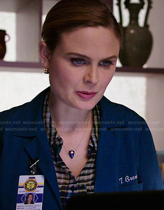 Brennan's plaid blouse and blue triangle necklace on Bones