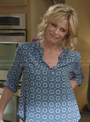 Claire's blue printed blouse on Modern Family