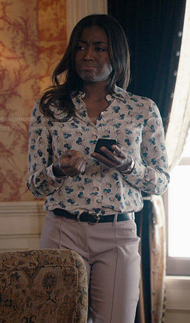 Daisy's floral print button down top and light pink trousers on Madam Secretary