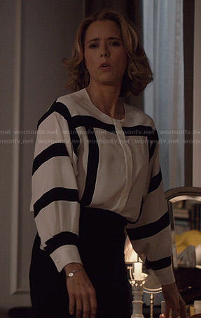 Elizabeth's white blouse with black striped sleeves on Madam Secretary