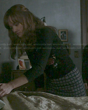 Emma's bird embroidered cardigan and grey checked skirt on Bates Motel