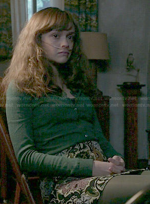 Emma's floral skirt and green cardigan on Bates Motel