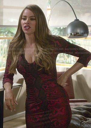 Gloria's red snake print dress on Modern Family