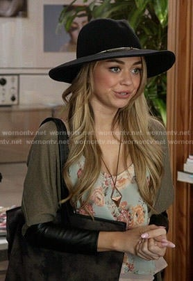 Haley's blue floral cami, leather cuffed cardigan and chain trim hat on Modern Family