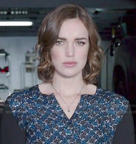 Jemma's blue printed blouse with black sleeves on Agents Of SHIELD