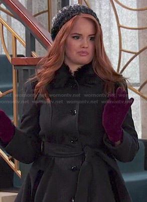 Jessie's black coat with fur collar on Jessie