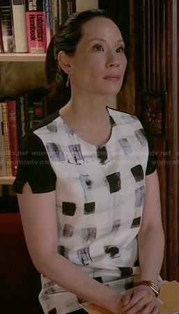 Joan's black and white square print top on Elementary