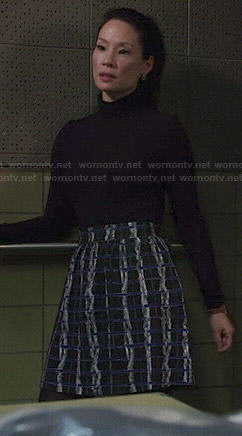 Joan's blue and black textured print skirt on Elementary
