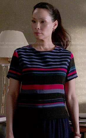 Joan's blue and red striped top on Elementary