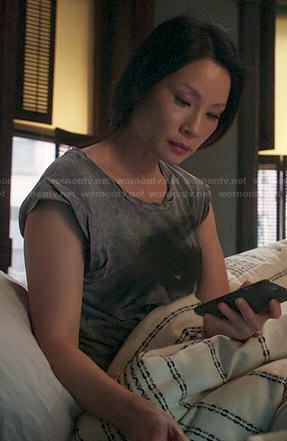 Joan's grey eye tee on Elementary