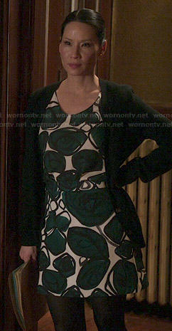 Joan's green leaf print dress on Elementary