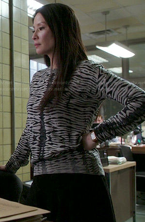 Joan's grey zebra striped sweater on Elementary