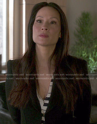 Joan's striped dress and long black coat on Elementary