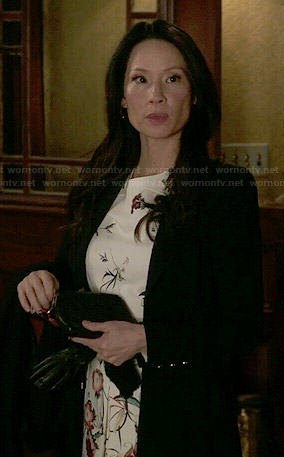 Joan's floral dress and black coat on Elementary