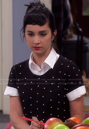 Mandy's black pearl studded top on Last Man Standing