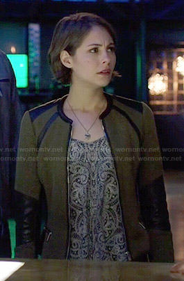 Thea's olive green jacket with leather trim and paisley printed top on Arrow