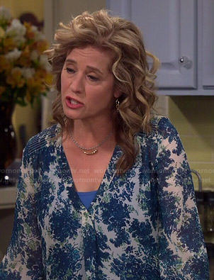 Vanessa's blue printed v-neck blouse on Last Man Standing