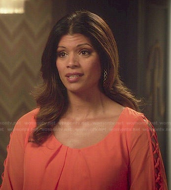 Xiomara's orange lattice-sleeve dress on Jane the Virgin