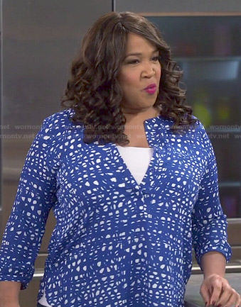 Yolanda's blue and white printed blouse on Young and Hungry
