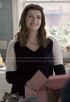 Annie's black and white colorblock sweater on Marry Me