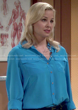 Avery's turquoise blue flap pocket blouse on The Young and the Restless