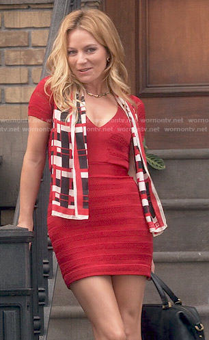 Caryn's red bandage dress and black bag on Weird Loners
