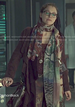 Cosima's long burgundy coat and lace top on Orphan Black