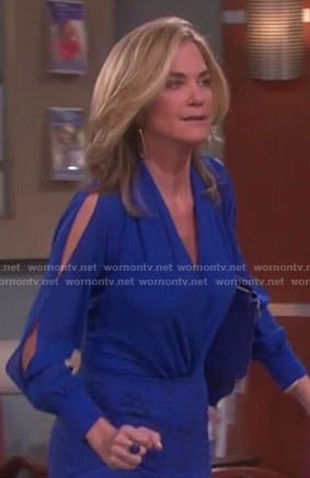 Eve's blue wrap blouse with split sleeves on Days of our Lives