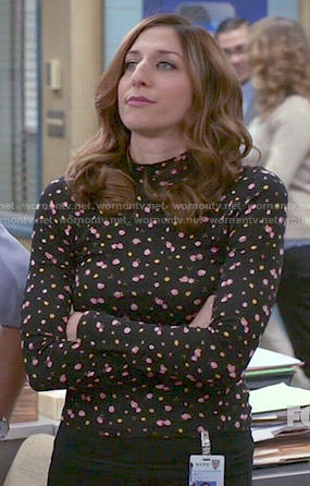 Gina's black floral mock-neck top on Brooklyn Nine-Nine