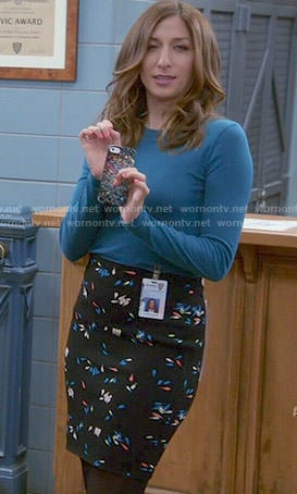 Gina's petals print skirt and blue top on Brooklyn Nine-Nine