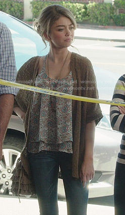 Haley's printed top and brown cardigan on Modern Family
