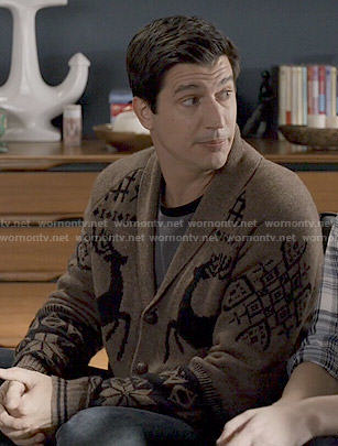 Jake's brown reindeer cardigan on Marry Me