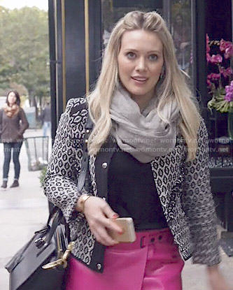 Kelsey's black and white patterned jacket and pink leather skirt on Younger