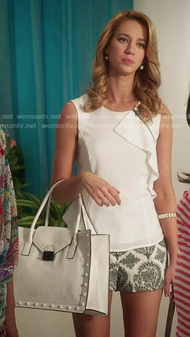 Petra's white ruffled top with printed shorts and white studded bag on Jane the Virgin