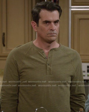 Phil's olive green henley tee on Modern Family