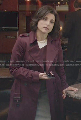 Selina's colorblock dress and burgundy trench coat on Veep