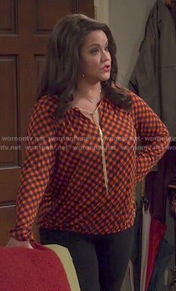 Victoria's orange checked top with chain neck on Mike and Molly