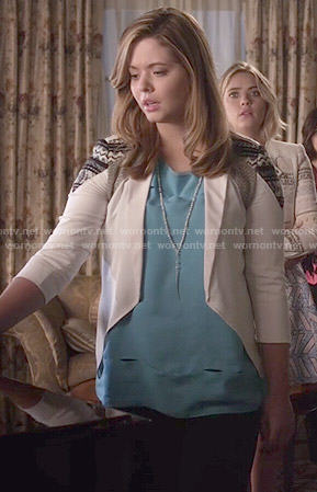 Ali's blue cutout top and white jacket on Pretty Little Liars