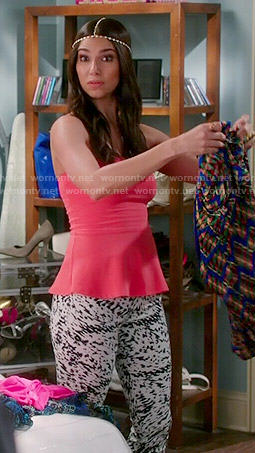 Carmen's pink peplum top and black and white printed jeans on Devious Maids