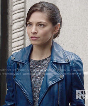 Cat's blue leather moto jacket and layered top on Beauty and the Beast