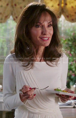 Genevieve's white draped front dress on Devious Maids