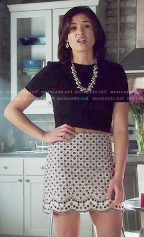 Heather's beaded skirt and black crop top on Beauty and the Beast