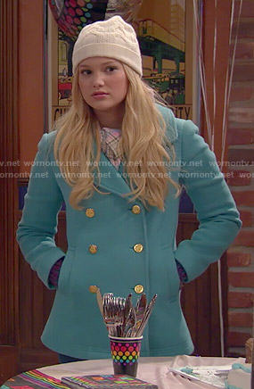 Lindy's turquoise blue coat, plaid scarf and white beanie on I Didn't Do It