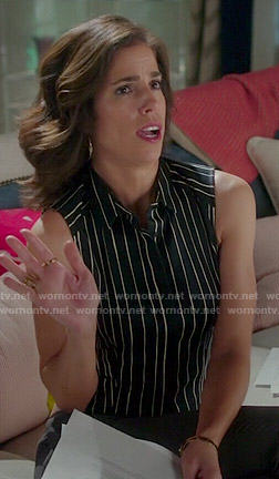 Marisol's black vertical striped sleeveless shirt on Devious Maids