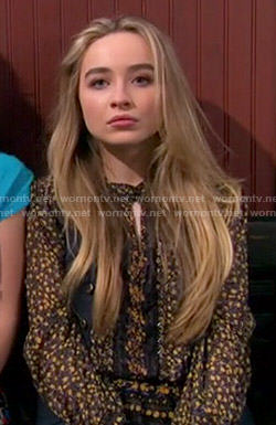 Maya's black and yellow floral long sleeve top on Girl Meets World