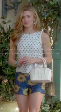 Paige's white sequin top and daisy print shorts on Royal Pains