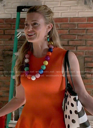 Paige's orange dress and striped polka dot bag on Royal Pains