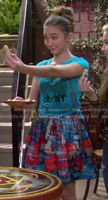 Riley's blue and red printed skirt and LA / NY tee on Girl Meets World